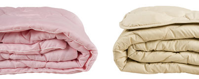 Parts of pink and beige blankets Royalty Free Stock Images