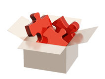 Parts of a puzzle in cardboard box Royalty Free Stock Images