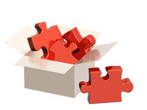 Parts of a puzzle in cardboard box Stock Photos