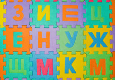 Parts of Puzzle are scattered on the floor Royalty Free Stock Photography