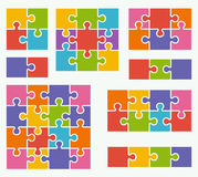 Parts of puzzles on white background in colored colors. Illustration Stock Images