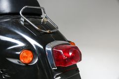 the rear part of the vintage scooter. rear light of old moped. stock photos