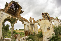 Parts of a ruined house with dramatic sky Royalty Free Stock Images