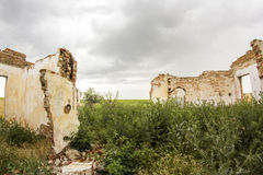 Parts of a ruined house with dramatic sky - different textures and herbs Royalty Free Stock Photo