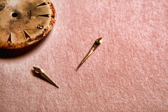 Parts Of Watch. Old watch pieces in poor condition on parchment paper Royalty Free Stock Image