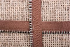 Parts of the zipper on linen canvas  background Stock Image