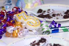 After the party 1. A table is strewn with left overs from a childs birthday party royalty free stock photo