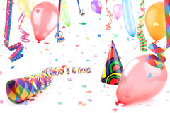 Party 1. Streamers,balloons and party hat in confetti rain stock photography