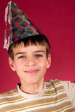 Party. Seven years old boy in party hat Royalty Free Stock Image
