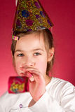 Party. Young girl enjoying a party  in christmas cap Royalty Free Stock Photography