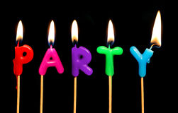 Party. Blazing candles spelling out party Royalty Free Stock Photography