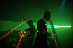 Party. Dancers with lasers & lighting toys at a party Royalty Free Stock Photos