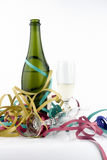 Party. A bottle of champagne with two glasses an streamer Stock Photos