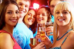 At party. Portrait of happy young people holding glasses of champagne Stock Photos
