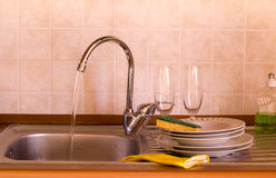 After the party. Washing dish after the feast Royalty Free Stock Image