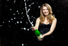 Party. Young elegant woman in party and celebration mood Stock Photos