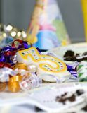 After the party 2. A table is strewn with left overs from a childs birthday party stock images