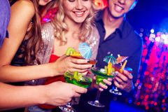 At party. Close-up of several cocktails in hands of young people during party stock images