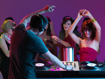 Party. Dj mixing at party, with ypung pretty girls dancing and smiling Royalty Free Stock Photo