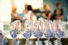 Party. Glasses prepared for  drinking. Women at the party in the background Royalty Free Stock Image