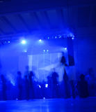 Party. People dancing and listening at a tecno music concert Stock Image