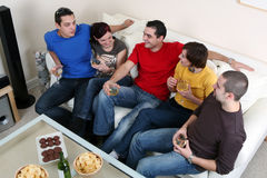 Party. Friends enjoying a celebratory drink of wine Stock Images