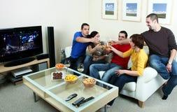 Party. Friends enjoying a celebratory drink of wine Stock Photos