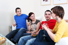 Party. Friends enjoying a celebratory drink of wine Royalty Free Stock Photo