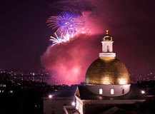 Party. Fourth of july fireworks explode in the sky over the charles river with the massachusetts state house in the foreground Stock Images