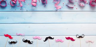 Party accessories against wooden background Stock Photo