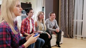 Party of adult group of adult friends. Happy group of male friends playing video games at home stock video footage