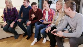 Happy group of male friends playing video games at home. Party of adult group of adult friends stock footage