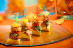 Party appetizer on platter. Party appetizers on colorful sticks served on platter Stock Images