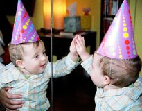 party baby reflexion in mirror  Royalty Free Stock Photos
