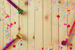 Party background with colorful confetti and party whistle stock images