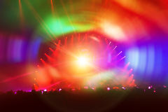 Party background. People enjoying concert, dancing in the night club with colorful lights on the stage, celebrating new year stock photography