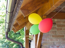 Party ballons on house Royalty Free Stock Photos