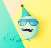 Party balloon with hat and glasses Royalty Free Stock Photo