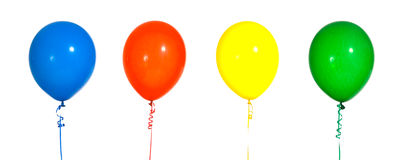 Party Balloons. Multicolred party balloons on strings with a white background Royalty Free Stock Photography