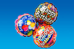 Party-balloons. Party balloons on blue background photographed in studio Royalty Free Stock Photo