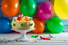 Party with balloons and a birthday cake Stock Images