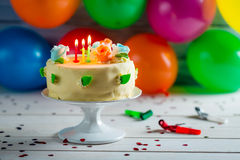 Party with balloons and a birthday cake Stock Photography