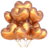Party balloons happy birthday decoration heart shaped golden Royalty Free Stock Photography