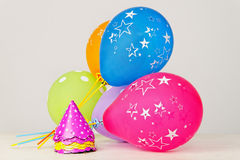 Party balloons and hats Stock Photography