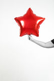 Party balloons and ribbons. Party red balloons star  and ribbons Royalty Free Stock Photo