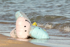 Party Balloons Washed Up on a Beach Stock Photography