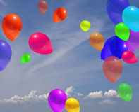 PARTY BALOONS. Multicolor baloon illustration shiny sky with rays of sun and puffy clouds Royalty Free Stock Image