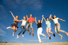 Party on beach. Group of happy young people dancing at the beach on  beautiful summer day Royalty Free Stock Photo