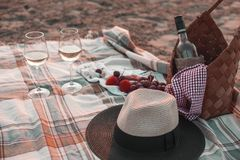 A party on the beach at sunset with wine. Romantic evening in the summer by the sea. Picnic. copy space.  royalty free stock photography