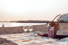 A party on the beach at sunset with wine. Romantic evening in the summer by the sea. Picnic. copy space.  stock images